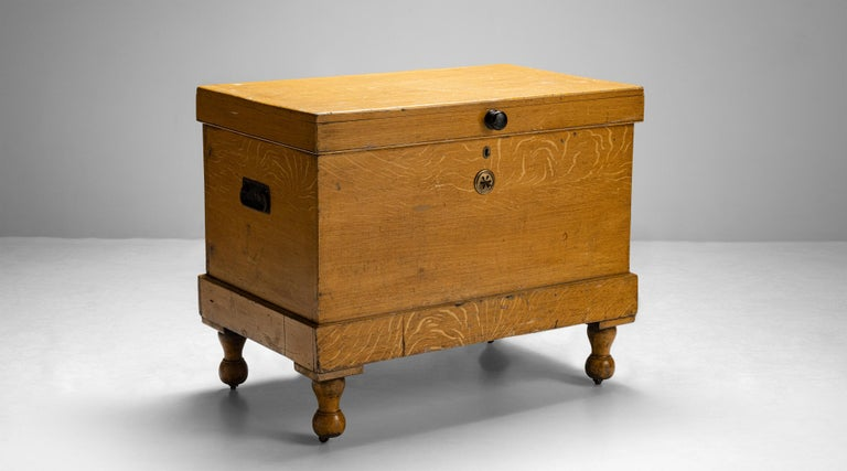 Faux oak chest England circa 1890 Large country house ice box with faux oak painted decoration on baluster turned legs with inset castors. Measures: 39.25