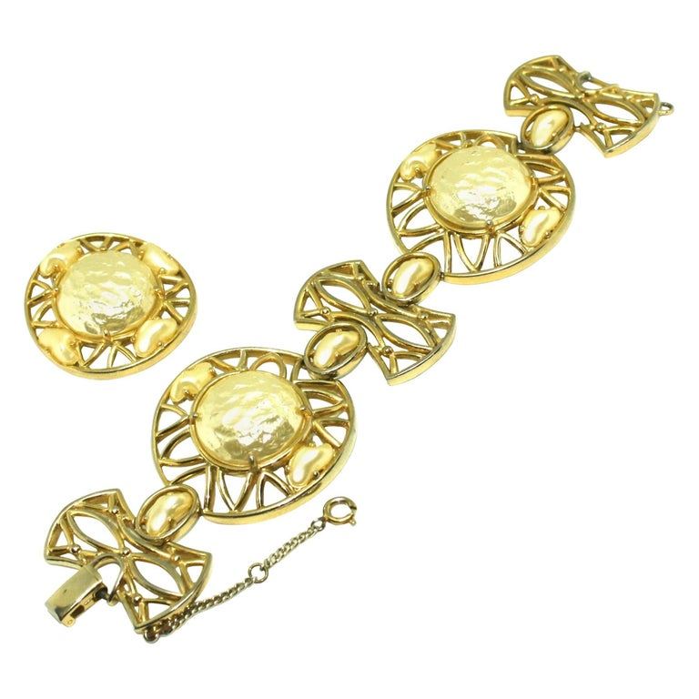 Chunky bracelet and large clip earrings suite featuring faux pearls set into an open geometric design by Elsa Shiapirelli. The bracelet features a safety chain and fold-over clasp, both in working order. All pieces are signed with the Shiapirelli