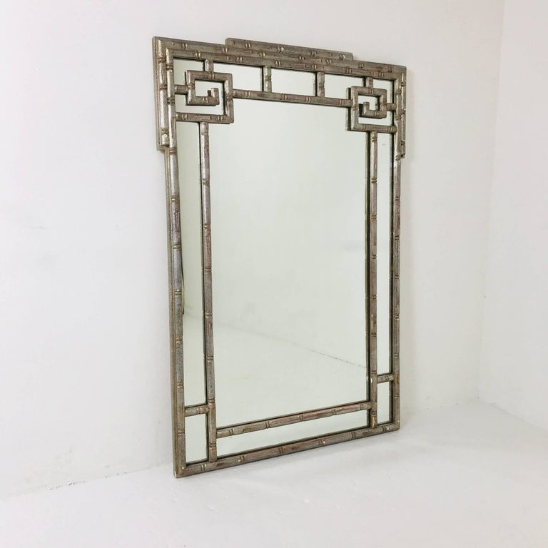 Faux silver leaf Greek key mirror. Mirror is in good vintage condition with wear due to age and use.