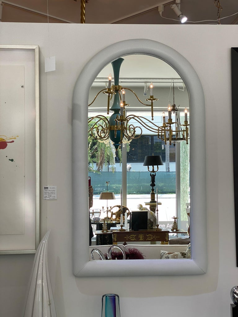 This stylish 1970s mirror is upholstered in a faux snakeskin vinyl and it is very much in the style of pieces created by Karl Sringer. The piece was acquired from an estate in South Beach Miami.