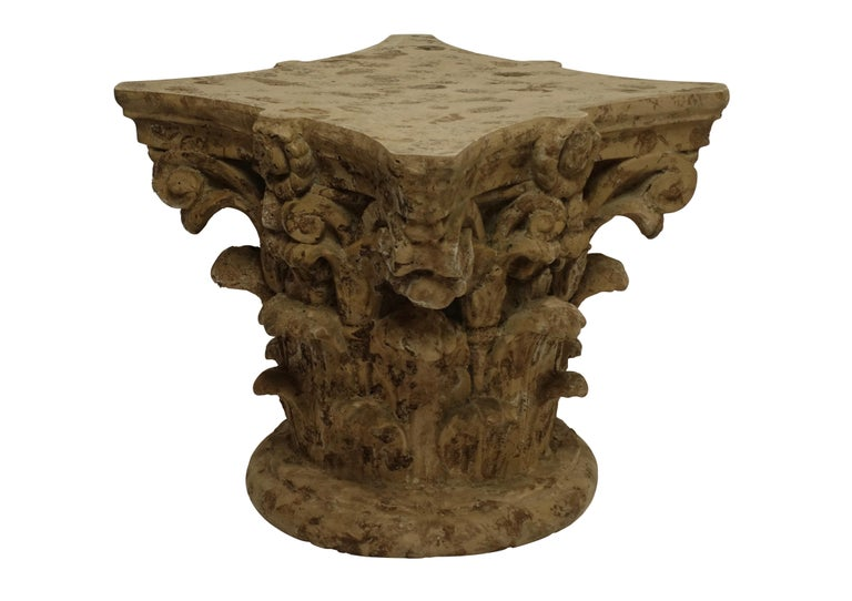 This low table is made of molded fiberglass and painted to look like the ruins of an ancient capital from a Corinthian/Ionic mix column, in the manner of a Michael Taylor design. American, mid to late 20th century. 