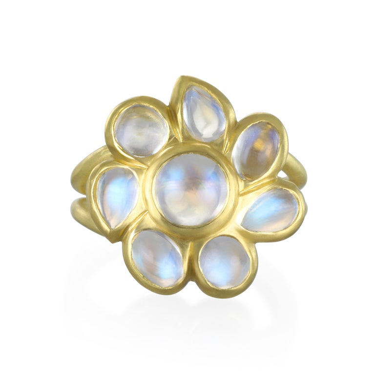Take a walk on the glamorous side with this Ceylon Blue Moonstone Daisy ring.  Known for its beautiful iridescence, the exciting blue flash adds to the overall mystique surrounding moonstones.  Organic shaped cabochon moonstones are what gives this