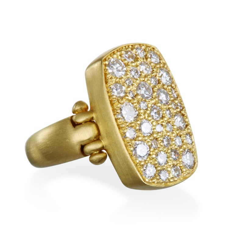 Faye Kim's 18k gold diamond chiclet ring with hinged detail is alluring and exquisite - sure to make a statement and become a signature piece in your wardrobe.  Diamonds are bead set and sparkle like diamonds in the night sky.  Dimensions:  .75