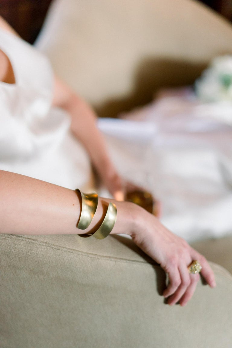 Faye Kim's Anticlastic Cuff boasts a modern design that is sure to make a statement and become a cherished treasure. Handcrafted using a technique that transforms a sheet of gold into an organic form with structural strength. Wrap your arm in this