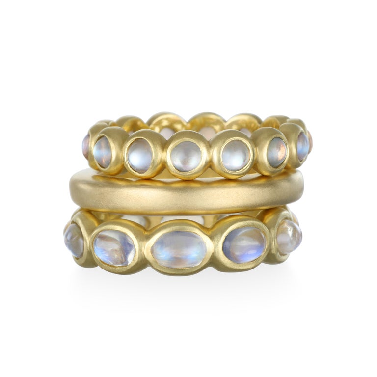 Faye Kim's  18K Gold Blue Moonstone Eternity Ring is a perennial favorite.  The blue sheen in the clear moonstone beautifully stands out against the matte gold.  The eternity style band can be worn either on its own or stacked - great stacked with