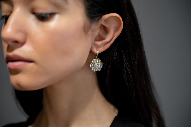 18k Gold Ceylon Moonstone Daisy Earrings.  Known for its adularescence, the blue flash from Ceylon moonstones adds to the overall mystique surrounding moonstones. In some cultures, moonstone is known as the stone of protection and considered sacred