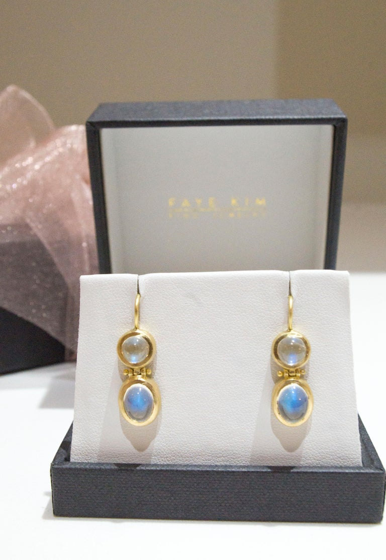 Faye Kim 18K Gold Double Ceylon Moonstone Hinged Earrings   These bold and beautiful 18k Gold double Ceylon Moonstone Bezel Earrings make quite a statement. The matte gold enhances the moonstones striking rainbow effect. Featuring matched