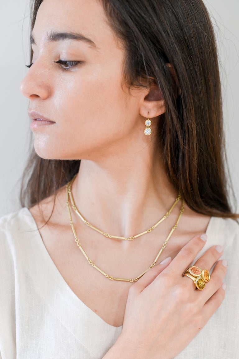 Handcrafted in solid 18k gold, Faye Kim's version of a Fob chain is refreshingly modern and fresh. Designed to be worn long, or doubled, the total length is 34