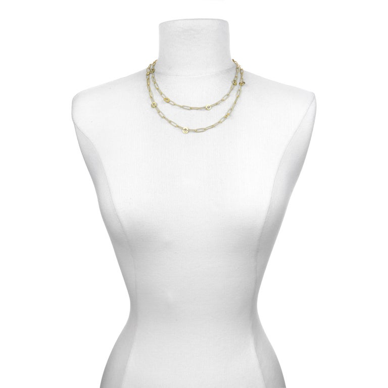 Experience everyday luxury. One of Faye Kim's best selling chains, the paperclip chain embellished with planished round links can be adjusted to multiple lengths or doubled for a shorter, layered look. Also terrific when layered with shorter