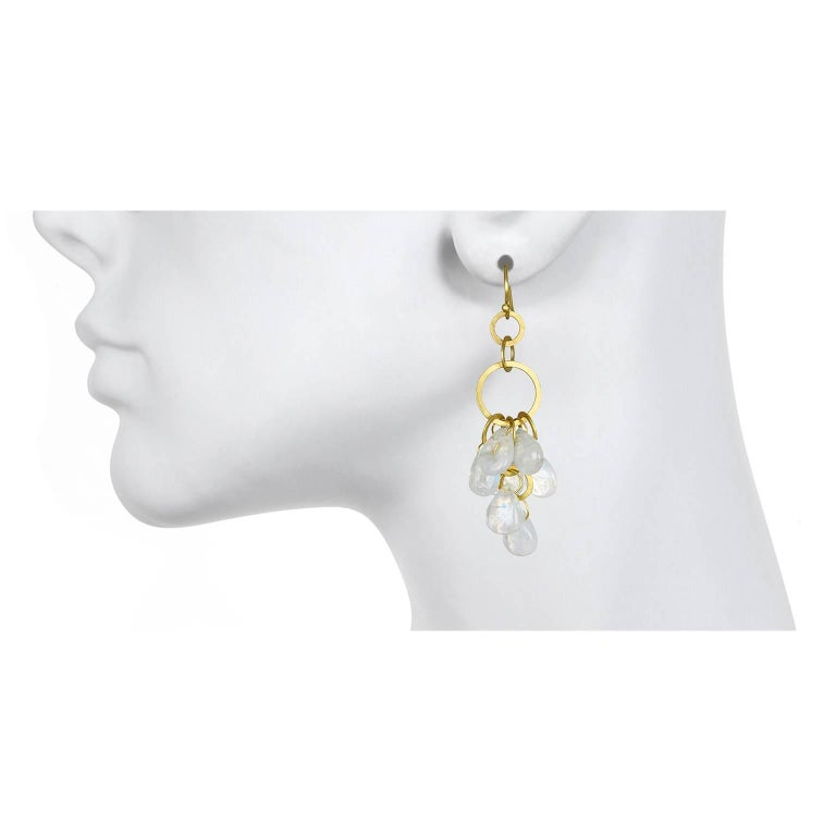 A perennial favorite, Faye Kim's earrings in 18k gold are handmade with shimmering moonstone briolettes.  Fun and versatile, moonstones are easy to pair with other colors and can easily go from day to evening. French ear wires. Matte