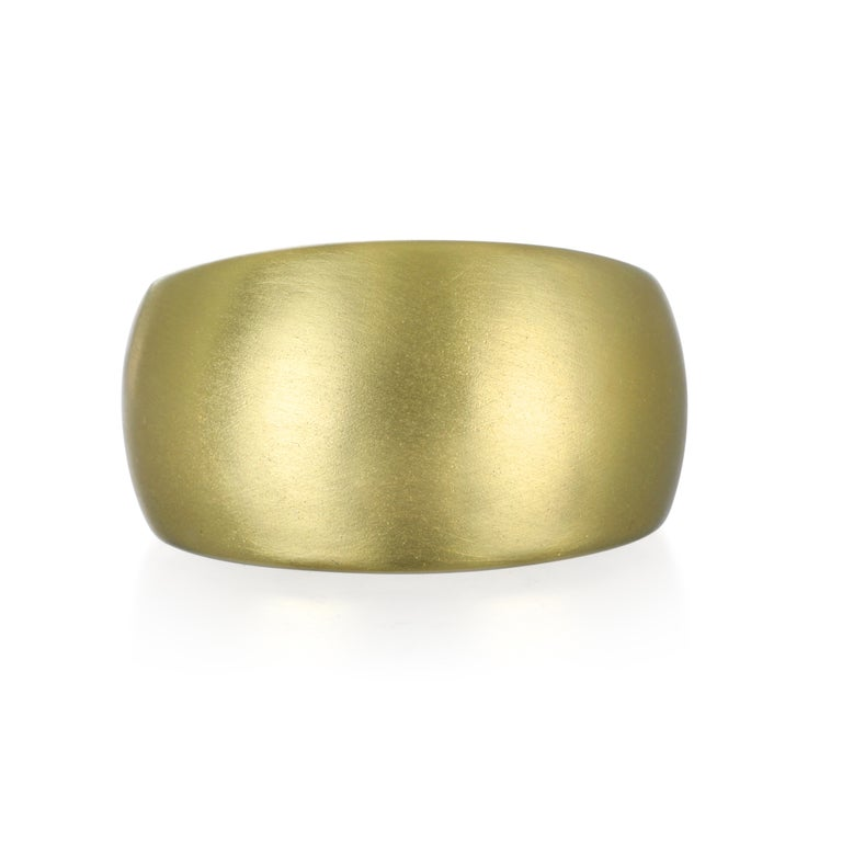 Faye Kim's updated version of the classic wide gold band in 18k matte gold is modern and fresh.  Sport a bold look with comfort, style, and elegance!  Size 6.5 14 x 7 MM