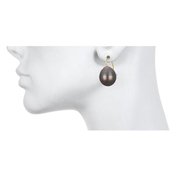 Classic, timeless, and simply chic - Black Tahitian cultured baroque pearl drops are finished with 18k gold ear wires.  Designed to hang just beneath the earlobe, these pearl drop earrings are a must-have in your jewelry wardrobe.  Color: Light