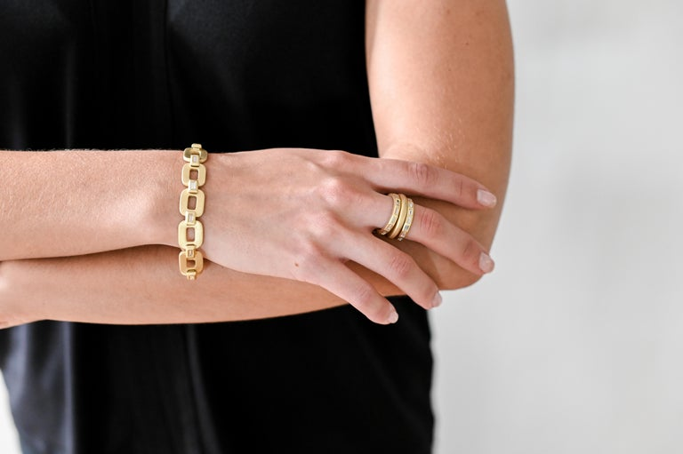 A modern-day classic! Faye Kim's handcrafted 18k gold link bracelet is quite substantial in weight and style. Each cushion-shaped link is polished, matte-finished and expertly linked with a Baguette diamond bezel. The clasp is skillfully crafted