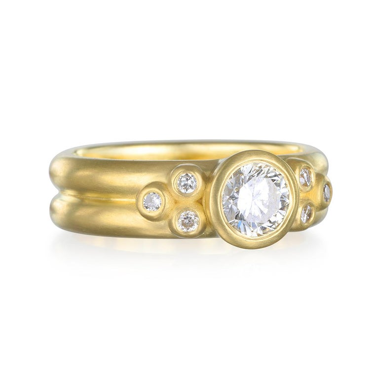 Beautifully handcrafted in Faye Kim's signature 18k Green Gold, a round brilliant cut diamond is bezel set and highlighted further by triple diamond Granulation beads. The double-width shank gives the ring an overall modern vibe that makes it a