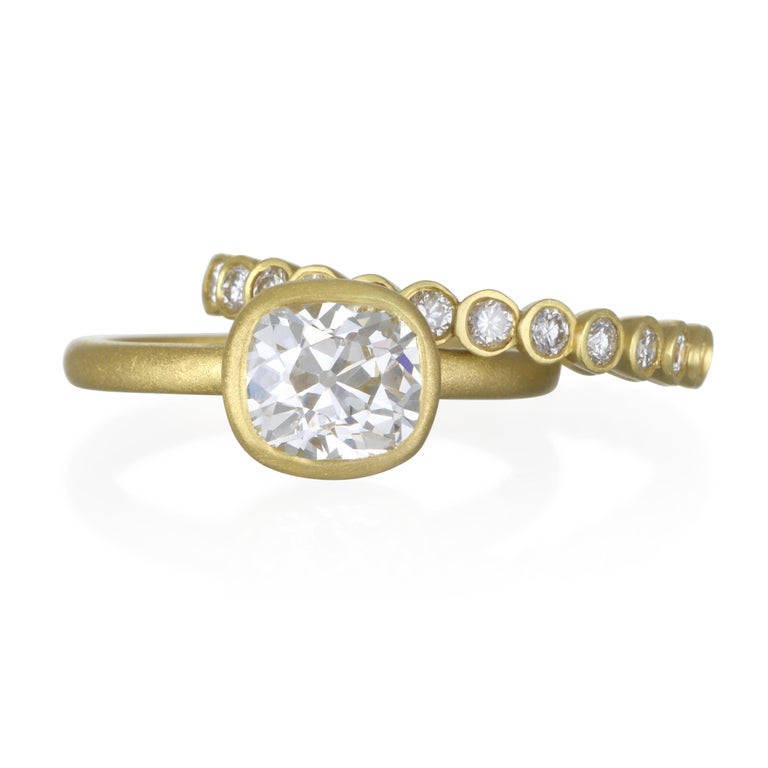 Faye Kim's 18k gold diamond bezel ring with a matte finish. Bright, white diamonds set in individual bezels for a clean and contemporary feel.    Diamonds:  1.04 Carats twt Width: 2.7 MM Size:  7