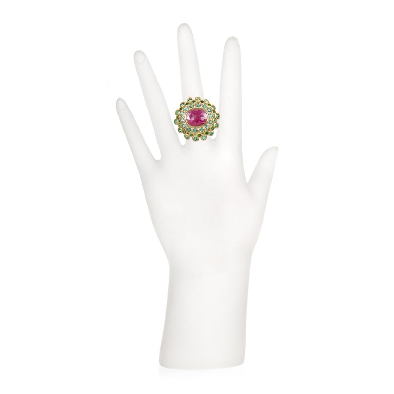 Faye Kim 18k Gold Madagascar Ruby Paraiba Tourmaline and Tsavorite Cocktail Ring.  Bold and beautiful, this one of a kind, over-sized ring is a showpiece with its eye-popping colors. The vibrant pink-red color of the Madagascar Ruby is enhanced by