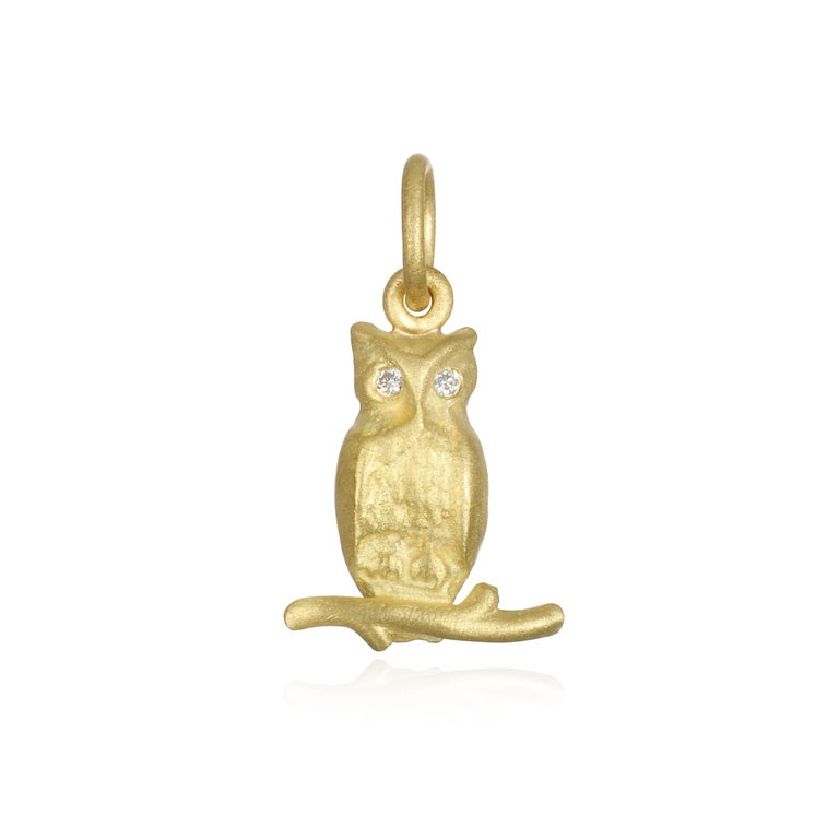 Symbolizing wisdom, truth, and knowledge, Faye Kim's 18k gold Owl with diamond eyes, perched on a branch is beautiful, wise and charming!  Owl Length x Width:  .6