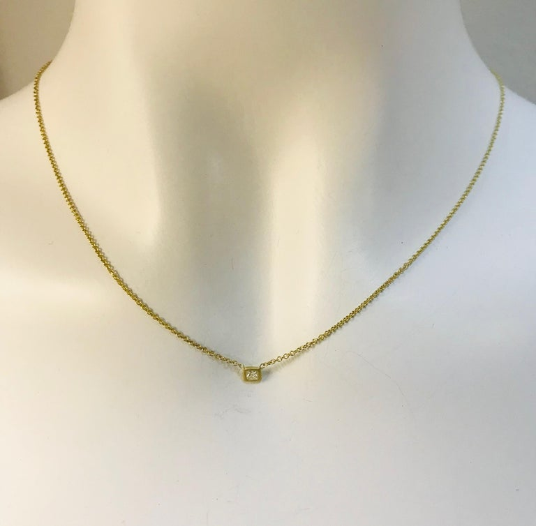 Faye Kim 18k Gold Princess Cut Diamond Solitaire Necklace  It's the perfect necklace for a special birthday, anniversary, graduation or just about any memorable event.   Set in 18k gold,  the matte finish makes the diamond really sparkle.  Delicate