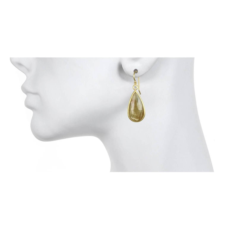 Simple, elegant and beautiful!  Handcrafted in 18k, rose cut yellow sapphire teardrop shaped slices are bezel set and paired with bezel set diamonds. The diamonds contrast and add a sparkle to the sapphire drop earrings. Understated and easy to