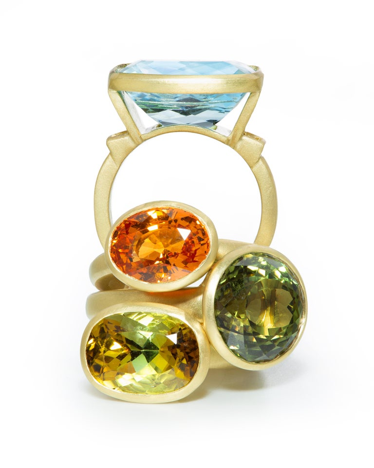 Cushion Cut Yellow-Olive Tourmaline Ring. The translucent olive-green color of this stylish tourmaline ring mesmerizes and makes a statement all on its own. Its rich hue is not only elegant, but serves to embody all of the textures and colors