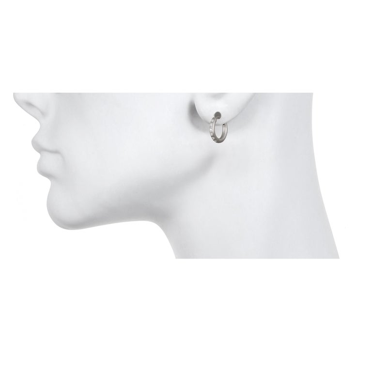 Faye Kim Matte Platinum Burnished Diamond Huggy Hoop Earrings  These handcrafted huggy hoops are your new go-to earrings.  Whether you're conducting the next board meeting or having brunch with friends, these earrings are the perfect modern look.
