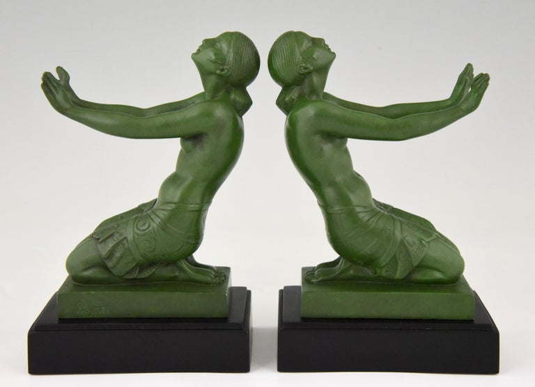 """A pair of typical Art Deco figural nude bookends figuring two kneeling women with outstretched arms signed Fayral, this is the pseudonym of Pierre Le Faguays for the models he designed for Max Le Verrier.  France 1930.   """"Statuettes of the Art"""