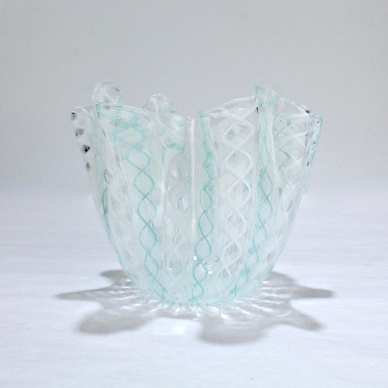 A fazzoletto or 'handkerchief' glass vase in teal green and white.  Designed by Fulvio Bianconi and Paolo Venini for Venini glass.  An iconic Mid-Century Modern form and an essential piece of Italian glass.  The base bears a 3 line acid-etched