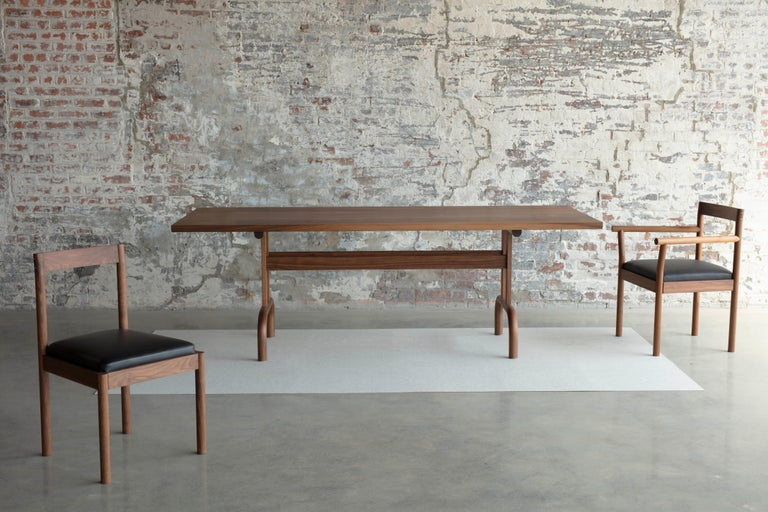Feast dining table is designed for a group of people dining together. It is handcrafted with exquisite craftsmanship. Celebrate and gather with family and friends. It is a minimal design with the careful detail of function, proportion, and material
