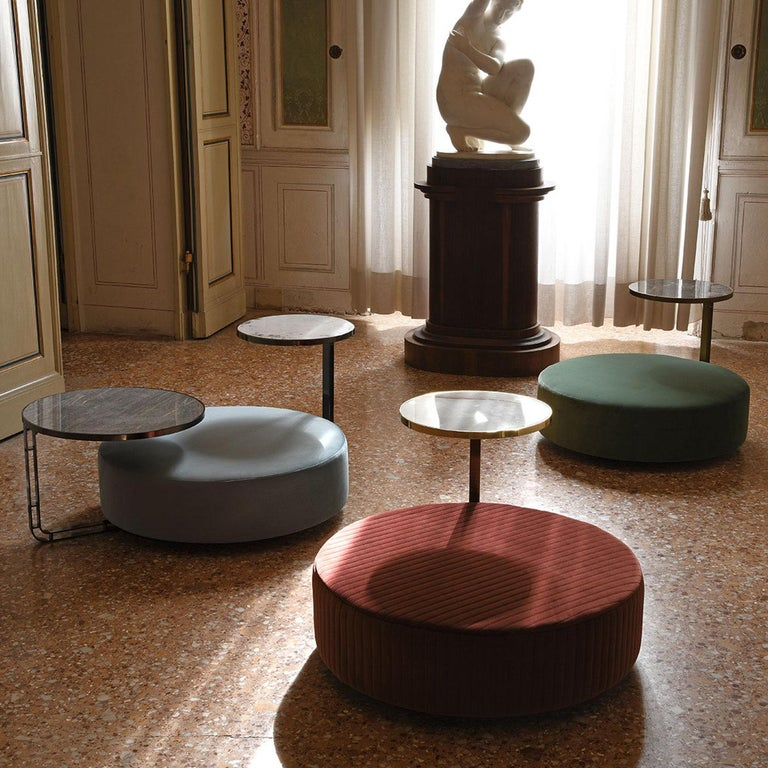 This glamorous pouf will add a luxe accent to any cool-toned, contemporary interior. Part of the Eos Collection inspired by the Greek goddess of dawn, the design rests on a plinth laminate base flaunting a glowing, satin chrome finish and is