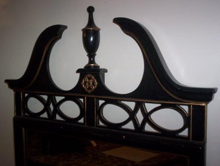 Black Federal style wood mirror with gilt detailing.