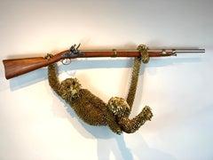 Monkey on Rifle