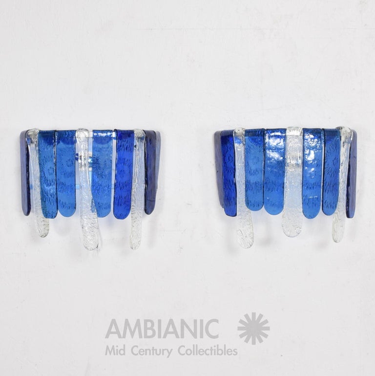 For your consideration: 1970s Mexico Mid-Century Modernism pair of hand blown glass wall sconces in a luscious blue and clear glass, attribution Feders- the renown Mexican modernist glass workshop featuring designs by Mexico City artisan Felipe