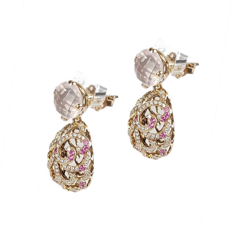 Fei Liu Fine Jewellery 18ct rose gold large hollow filigree drop earrings. Featuring round rose quartz, which suspend hallow filigree-detailed eggs, which are set with pink sapphires and diamonds.. A charming pair of earrings with a touch of glamour