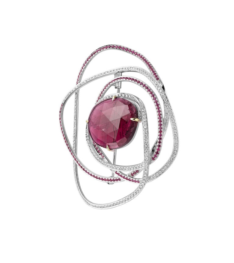 Description: Fei Liu one-off brooch with 10.71ct rose cut rubellite, 1.01ct white diamonds and 1.081ct pink sapphires. Set in 18ct white gold.  Inspiration: A modern take on the ever beautiful rose. The sleek asymmetric lines of the pink sapphires