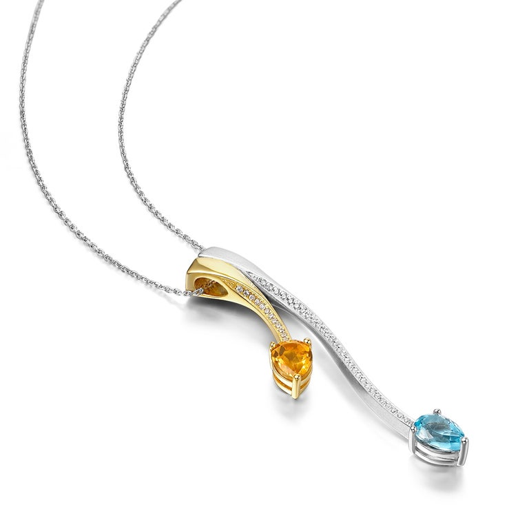 Description: Shooting Star two-tone pendant with pear cut blue topaz and citrine, and Hearts and Arrows* white cubic zirconia, set in brush polished white rhodium plate and mirror polished 18ct yellow gold plate on sterling silver.  *Hearts and