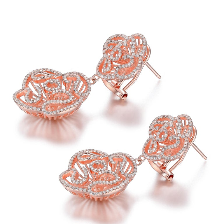 Description: Cascade double drop earrings shimmering with Hearts and Arrows* cubic zirconia, set in 18ct rose gold plated on sterling silver.  *Hearts and Arrows refer to the diamond cut quality. Our cubic zirconia is cut with 28 extra facets to