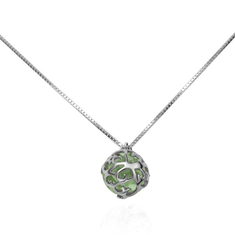 Description: Whispering small round stone pendant with a central 2.2ct green amethyst set in black rhodium plate on 18ct white gold. Chain length is 16 inches + 1 inch extension.  Inspiration: Emulating femininity and glamour, the Whispering