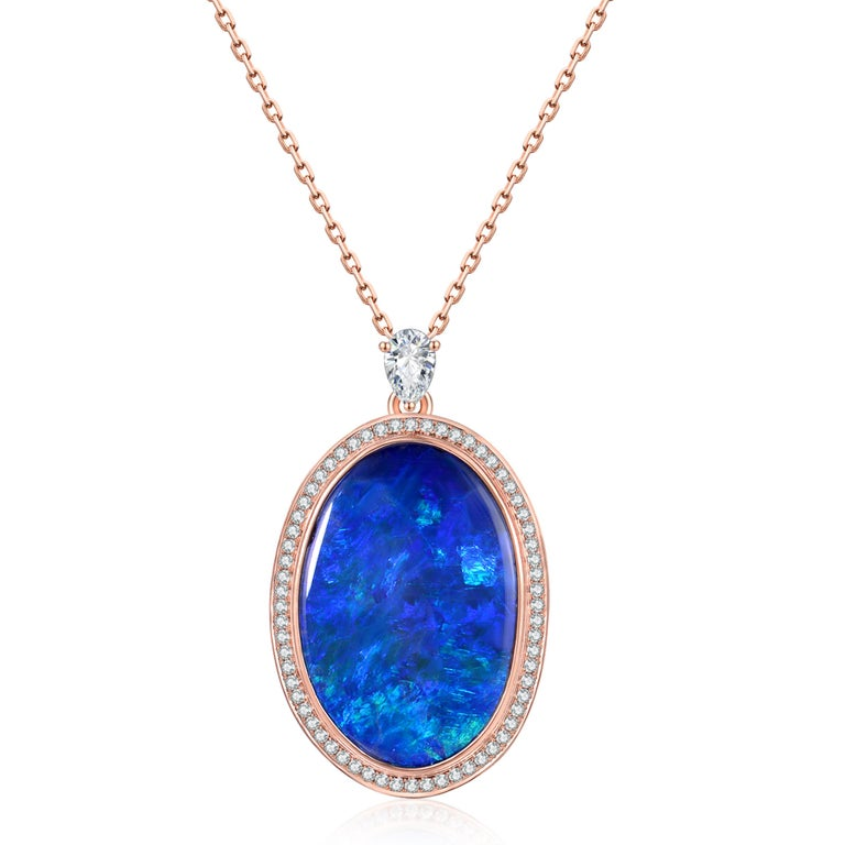 Description: A one-of-a-kind deep blue boulder opal with a weight of 6.1ct, bordered by a halo of brilliant diamonds with a total weight of 0.32ct, set in 18ct rose gold.  Opal care: Clean opals with luke-warm soapy water.  Specification: Size
