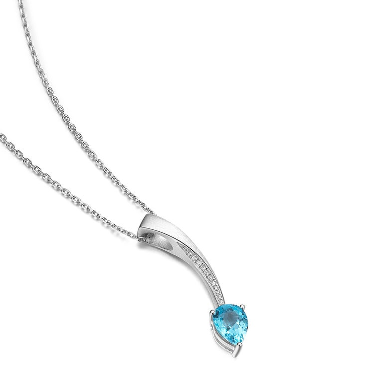 Description: Shooting Star short pendant with pear cut blue topaz and Hearts and Arrows* white cubic zirconia, set in brush polished white rhodium plate** on sterling silver.  Chain length is 16 inches + 2 inch extension  *Hearts and Arrows refer to