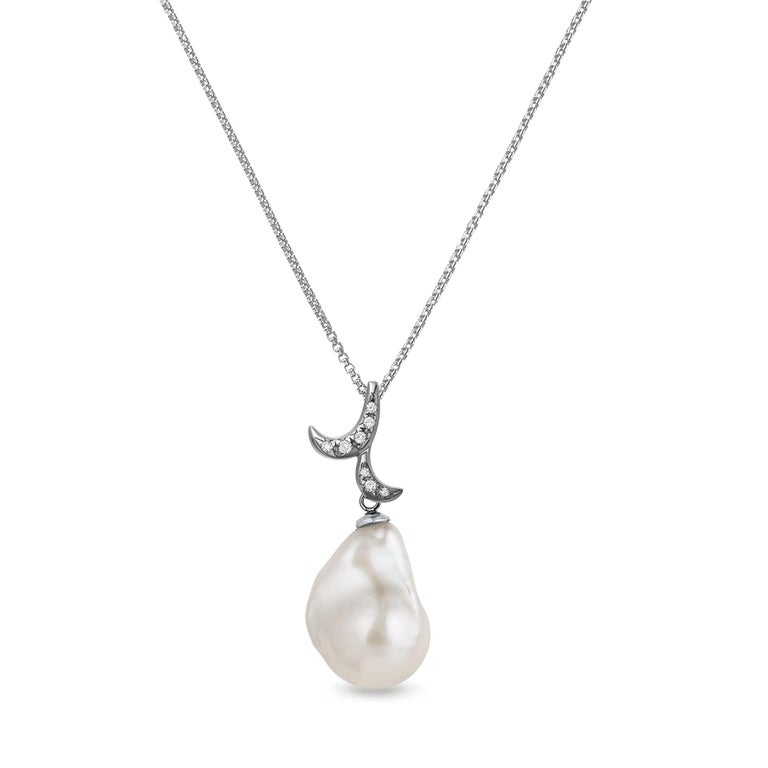 Description: Whispering baroque pearl pendant with 0.03ct white diamonds and a 12mm x 14mm baroque pearl, set in black rhodium plate on 18ct white gold. Chain length is 16 inches + 1 inch extension.  Inspiration: Emulating femininity and glamour,