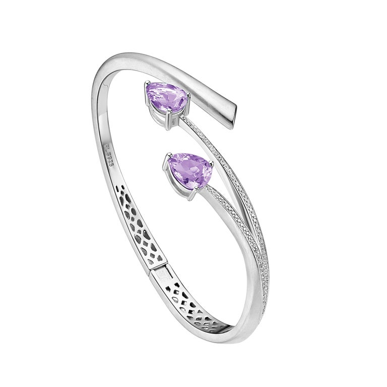 Description: Shooting Star bangle with pear cut purple amethyst and Hearts and Arrows* white cubic zirconia, set in matte polished white rhodium plate on sterling silver.  Inner diameter (LxW): small/medium = 56mm x 60 mm, large = 60mm x