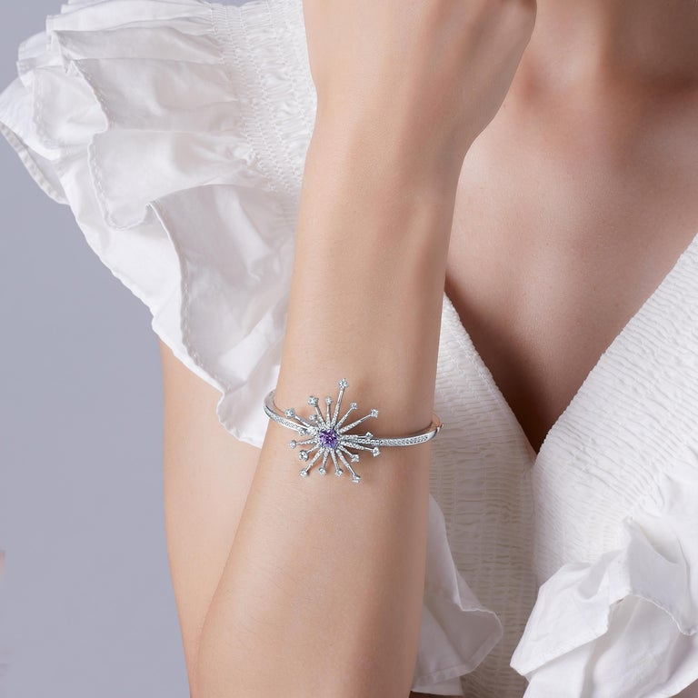 Description: Light up the room with the new Carpe Diem Collection by Fei Liu! Carpe Diem 'Sparkler' bangle with Swarovski Purple-Aqua Pentagon Star cubic zirconia and 8 hearts and 8 arrows CZ, set in white rhodium plate on sterling