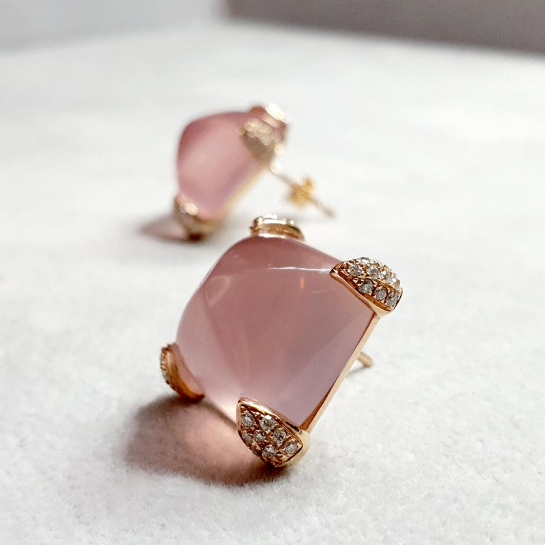 Description: One-off asymmetric rose quartz earrings with diamond-set claws, set in 18ct yellow gold.  Inspiration: Enhancing the natural beauty of the rose quartz cabochon with the delicate sparkles of the diamonds. These earrings are utterly