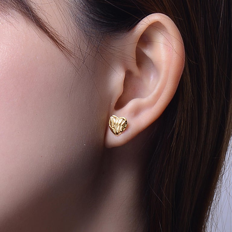 Description: Dainty 'Heart' stud earrings with 'love' inscription in 18ct yellow gold plate on sterling silver.  Inspiration: The limited edition Heart Collection epitomises love is love, and it knows no bounds. Our heart motifs make for a