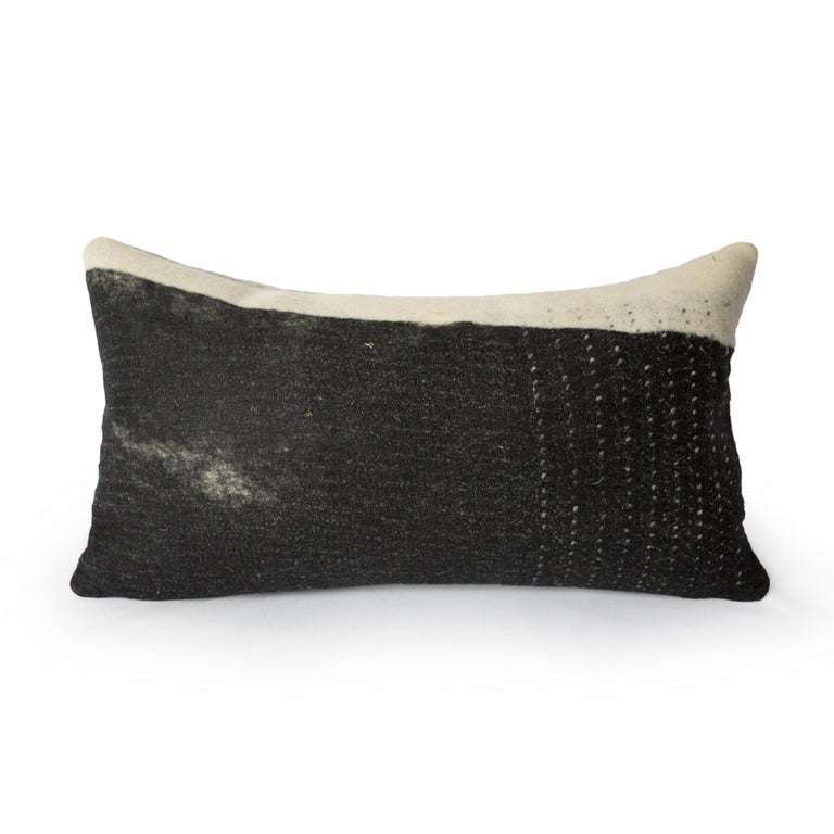 Milled in JG Switzer's design workshop, this pillow is named after the sheep that adorn its face, the long-locked Wensleydale, mostly because