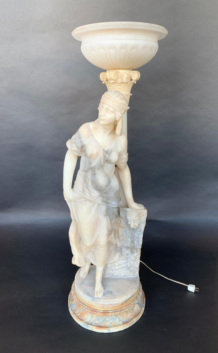 Sculptural torchère lamp of a woman, made of marble and alabaster.