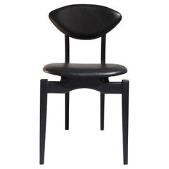 Femur Black Dining Chair in Walnut and Leather by ATRA