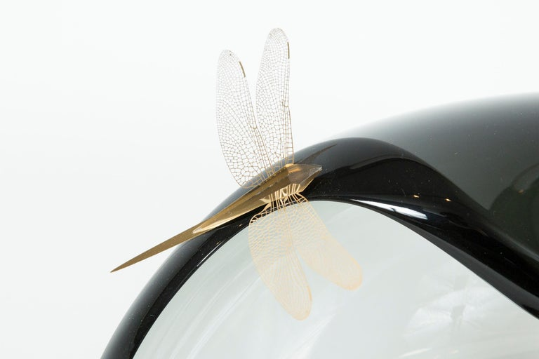 Each dragonfly is made from laser cut sheet steel which has been gold plated and adorned with a cut glass abdomen. The steel is thin enough to allow the wings to flutter. 