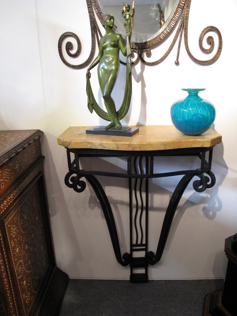 French Art Deco period wrought iron console table and mirror with sienna marble top.