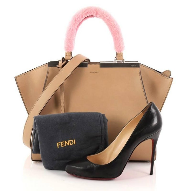 2c03669e885d This authentic Fendi 3Jours Handbag Leather with Shearling Petite is an  impeccably stylish update from its
